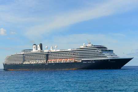 cay: Holland American Line Cruise ship Zuiderdam anchore offshore in Half Moon Cay Little San Salvador Island Bahamas.