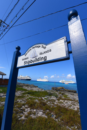 shipbuilding: Sign of Shipbuilding on Maritime Heritage Trail with Cruise ships on the seas at George Town, Grand Cayman, Cayman Islands. Editorial