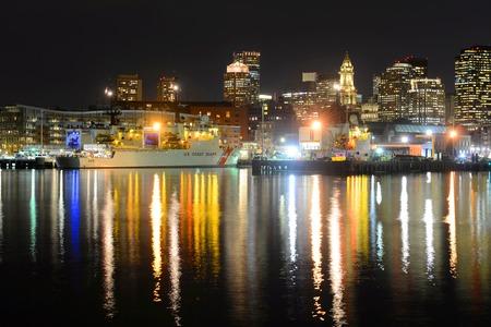 spencer: Boston City Skyscrapers, Custom House and USCGC Spencer WMEC-905 at night from East Boston, Boston, Massachusetts, USA Editorial