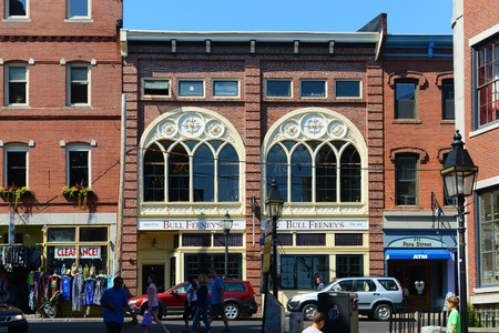 brick building: Portland Seamans Club at Old Port. This area is filled with 19th century brick buildings and is now the commercial center of the city, Portland, Maine, USA.