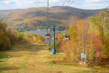 Lake Tremblant and Mont-Tremblant village in fall with fall foliage, from top of Mont Tremblant, Quebec, Canada.