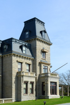historical building: Chateau-Sur-Mer is a historic house with Chateau style at Newport Historic District in Newport, Rhode Island, USA. This house, built in 1852, was home to three generations of the Wetmore family. Stock Photo