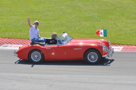 MONTREAL, CANADA - JUN 10, 2012: Sergio Perez of Sauber F1 Team in 2012 Formula 1 Canadian Grand Prix drivers parade in Circuit Gilles Villeneuve, Montreal on June 10, 2012 in Quebec, Canada. Editorial