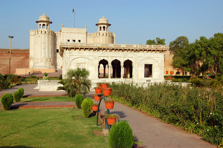 mughal: Alamgiri Gate and Hazuri Bagh Pavilion of Lahore Fort in Old City Lahore, Pakistan. Alamgiri Gate, built in 1673 AD is the main entrance to Lahore Fort.   Editorial