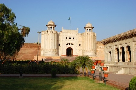 Alamgiri Gate and Hazuri Bagh Pavilion of Lahore Fort in Old City Lahore, Pakistan. Alamgiri Gate, built in 1673 AD is the main entrance to Lahore Fort.   Editorial