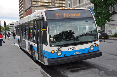original ecological: MONTREAL - JUN 8: Montreal Express Bus #45 on June 8, 2012 in downtown Montreal, Quebec, Canada.
