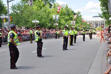 OTTAWA, CANADA - JULY 1: RCMP police on guard on Canada Day on July 1, 2011 in Ottawa, Ontario, Canada.
