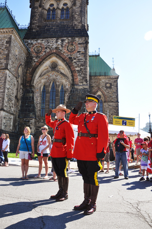 OTTAWA, CANADA - JULY 1: RCMP Police with antique red uniform solute on Canada Day in the parliament plaza on July 1, 2011 in Ottawa, Ontario, Canada.