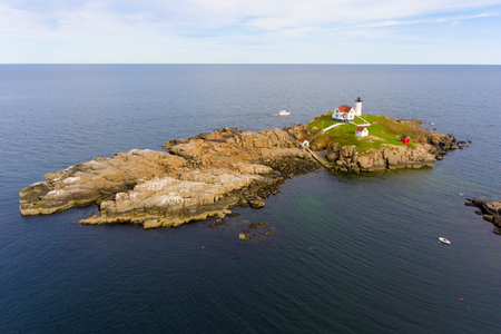 Cape Neddick Lighthouse (Nubble Lighthouse) aerial view at Old York Village, Maine, USA. Stock Photo