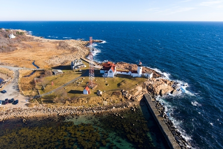 Aerial view of Eastern Point Lighthouse and Gloucester Harbor, Cape Ann, northeastern Massachusetts, USA. This historic lighthouse was built in 1832 on the Gloucester Harbor entrance. Stock Photo