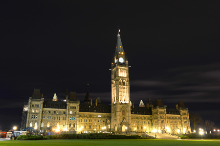 gothic revival: Canada Parliament Building and clock tower at night, Ottawa, Canada.