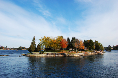 One Island in Thousand Islands Region in fall of New York State, USA. Stock Photo