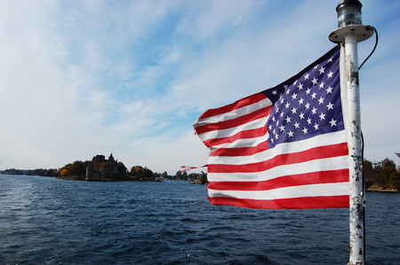 politic: USA National Flag on St. Lawrence River in Thousand Islands, New York, USA.