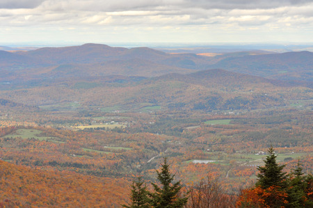 Fall Foliage of Green Mountains from top of Sterling Mountain near Smugglers Notch in Vermont, USA.