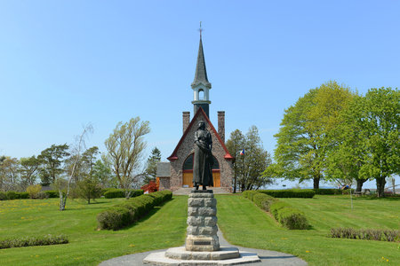 Memorial Church in Grand-Pré National Historic Site, Wolfville, Nova Scotia, Canada. Grand-Pré area is a center of Acadian settlement from 1682 to 1755. Now this site is a UNESCO World Heritage Site. Stock Photo