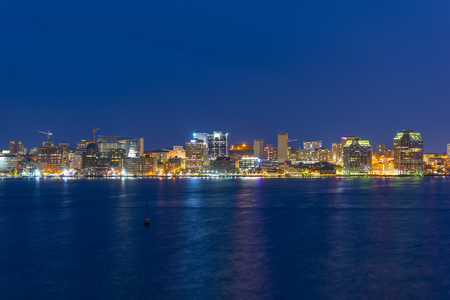 Halifax City skyline at night from Dartmouth waterfront, Nova Scotia, Canada. Stock Photo