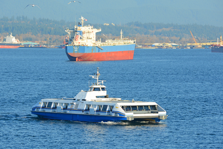 Vancouver Seabus crosses Burrard Inlet to connect Vancouver and North Vancouver, British Columbia, Canada.