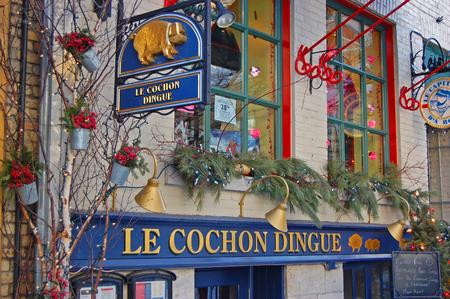 Le Cochon Dingue Restaurant on Rue du Petit-Champlain at Lower Town Basse-Ville in winter in Quebec City, Quebec, Canada. Historic District of Quebec City is UNESCO World Heritage Site since 1985. Redakční