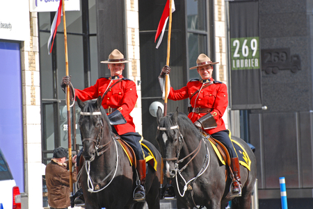 OTTAWA, CANADA - Mar. 10, 2012: RCMP riding in Saint Patrick's Day Parade in Ottawa, Canada.