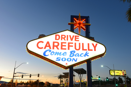 Drive Carefully Come Back Soon on the back of the famous Sign of Welcome to Fabulous Las Vegas at dusk on Las Vegas Strip in Las Vegas, Nevada, USA. Redakční