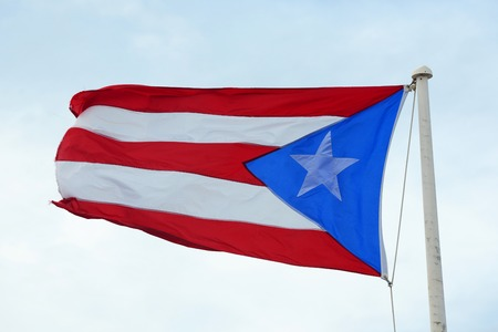 Flag of the Commonwealth of Puerto Rico at Castillo de San Cristobal, San Juan, Puerto Rico.