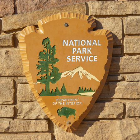 US national park service sign in Arches National Park, Moab, Utah, USA.
