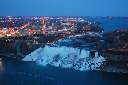 Aerial View of American Falls of Niagara Falls at night in winter, New York State, USA.