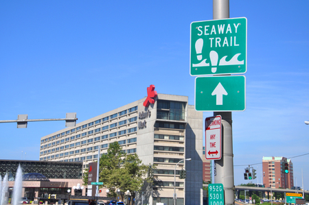 Sign of Seaway Trail with Adams Mark Hotel at the backgound in downtown Buffalo, New York, USA.