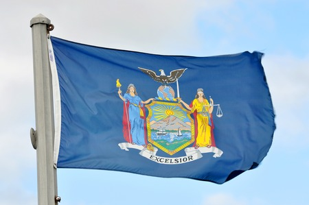 Flag of New York State in blue sky background. Stock fotó - 121569563