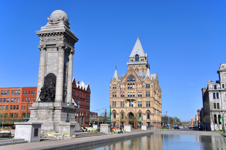 Soldiers and Sailors Monument and Syracuse Saving Bank Building at Clinton Square in downtown Syracuse, New York State, USA. Syracuse Savings Bank Building was built in 1876 with Gothic style. Editorial
