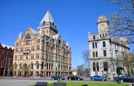 Syracuse savings Bank Building (left) and Gridley Building (right) at Clinton Square in downtown Syracuse, New York State, USA. Syracuse Savings Bank Building was built in 1876 with Gothic style.