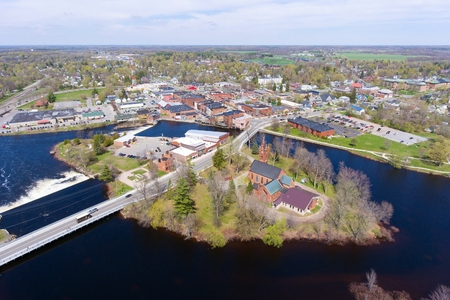Village of Potsdam aerial view including Trinity Episcopal Church on an island in Raquette River, Upstate New York, USA.