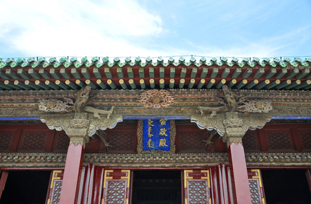 Plaque (Inscribed door plate) of Chongzheng Hall in the center of Shenyang Imperial Palace (Mukden Palace), Shenyang, Liaoning Province, China. Shenyang Imperial Palace is UNESCO world heritage site. Editorial