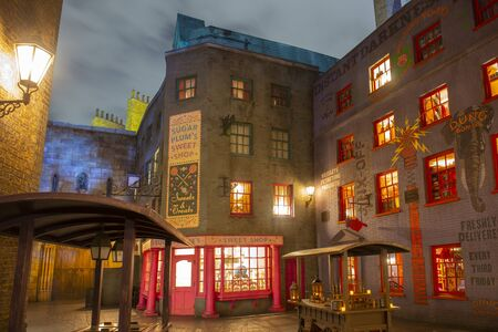 Diagon Alley at night in the Wizarding World of Harry Potter in Universal Orlando, Florida, USA.