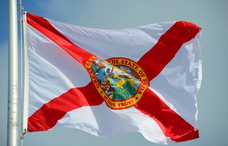 Flag of State of Florida in blue sky background