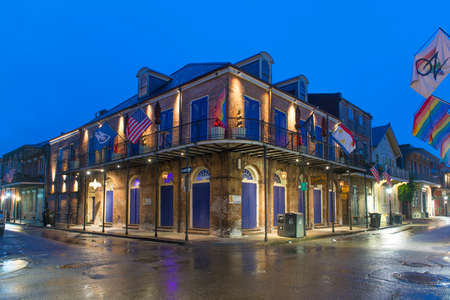 Historic Buildings at the corner of Bourbon Street and St. Ann Street in French Quarter at night in New Orleans, Louisiana, USA.