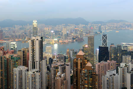 Hong Kong Skyline and Victoria Harbour at dusk from Victoria Peak on Hong Kong Island, Hong Kong, China. Stock Photo