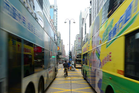 Double deck buses on Nathan Road in Kowloon, Hong Kong. Nathan Road is a main commercial thoroughfare in Kowloon, Hong Kong.
