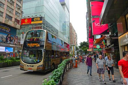 Double deck buses on Nathan Road in Kowloon, Hong Kong, China. Nathan Road is a main commercial thoroughfare in Kowloon, Hong Kong.