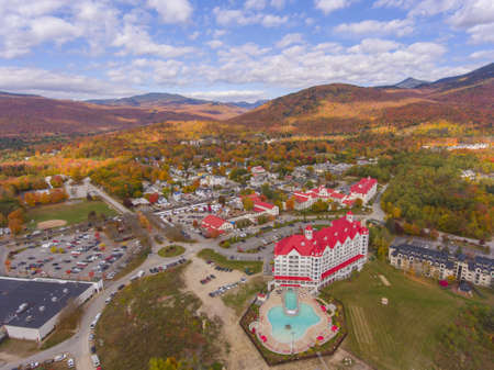 Lincoln town center and Kancamagus Highway aerial view with fall foliage, Town of Lincoln, New Hampshire NH, USA.