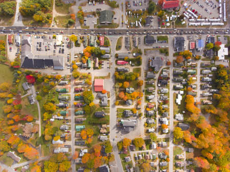 Lincoln Main Street at town center on Kancamagus Highway top view with fall foliage, Town of Lincoln, New Hampshire NH, USA.