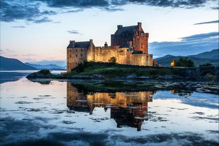 Eilean Donan Castle against water at the night, Scotland