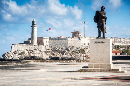 Statue of the Venezuelan revolutionary Francisco de Miranda, background fortress and lighthouse of El Morro in the entrance of Havana bay, Cuba