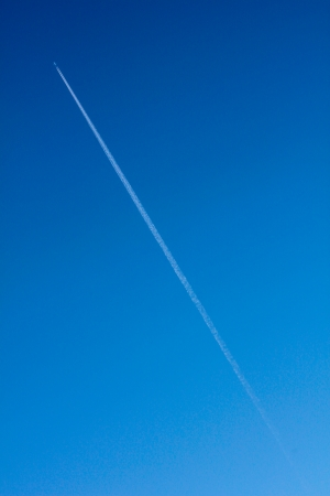 trace of an airplane against blue sky photo