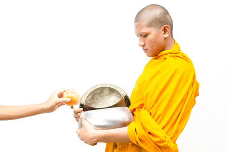human's arm: put food offerings in a Buddhist monk s alms bowl, thailand with isolate