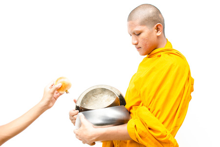 god s hand: put food offerings in a Buddhist monk s alms bowl, thailand with isolate