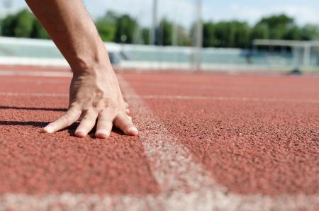 pista de atletismo: empezar la pista de atletismo Foto de archivo