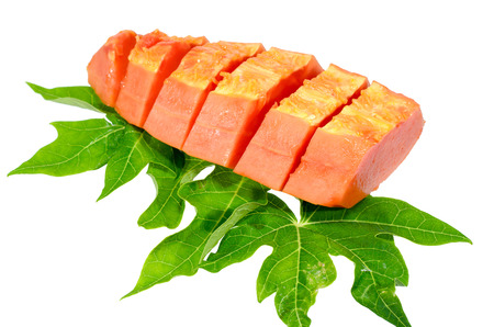 cutaneous: Sweet papaya on isolate with green papaya leaf