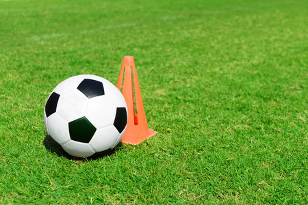ballsport: Soccer ball on soccer field and funnel  Stock Photo