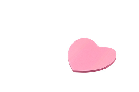 Pink paper heart isolated on a white background  photo